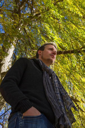 beardless: Young man in the shade of a willow tree