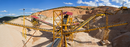 sand quarry: Panoramic view of gravel with ribbons distribution according to sizes in the gravel quarry outdoors  Stock Photo