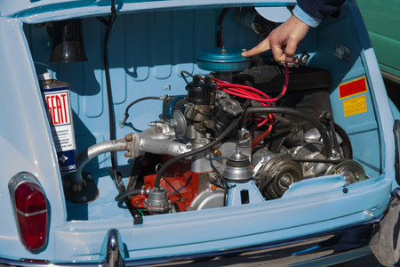 LEON, SPAIN - APRIL 27, 2014  Engine of a Classic Car Seat 600 at the XIV International Concentration  SEAT 600 of Leo�n  Finger pointing to the air filter of Vehicle manufactured in Spain between 1957 and 1973