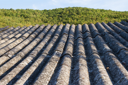 fibrous: Roof insulation built with asbestos fibrous material prohibited by their carcinogenic effects