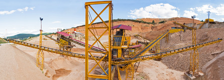 classifier: Panoramic view of gravel with ribbons distribution according to sizes in the gravel quarry outdoors