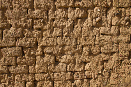Wall for background or texture of mud and straw bricks (adobe) baked in the sun