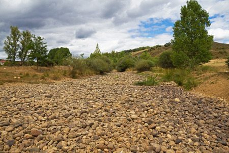 riverbed: Completely dry riverbed full of boulders in summer Stock Photo