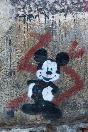 Leon, SPAIN - December 15, 2013: Mickey Mouse smiling Graffiti on a wall street
