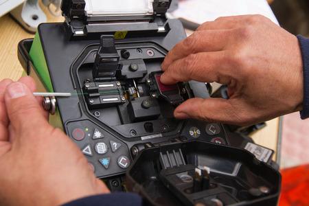 Technical wire splicing or fusing optical fiber splicing machine photo
