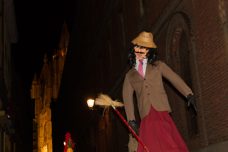 glove puppet: Straw strange figure dressed in costume and mask in Carnival Parade through the streets of Leon Spain