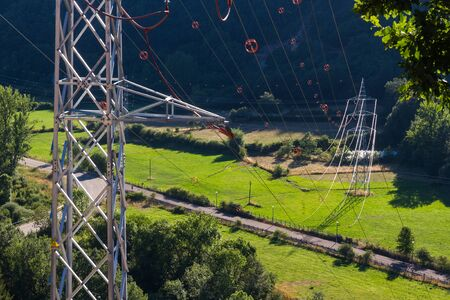 voltage gray: Electricity towers Pylons. Cables metallic electrical line diverter beacons in nature