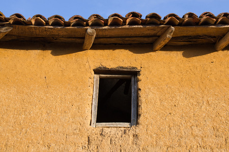 mud house: Mouth or window old wooden. House block or adobe or mud Stock Photo