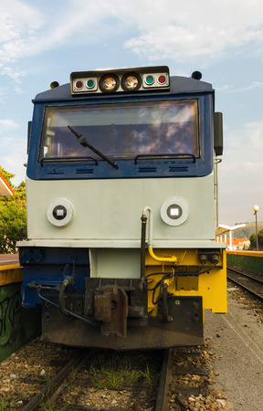 narrow gauge: Front view of locomotive narrow gauge train on the platform of the station. Powered with diesel and headlights