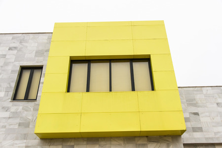 edification: Detail of modern edification with yellow windows Stock Photo