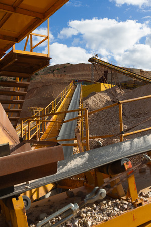 size distribution: Machinery and classification according gravel size distribution via conveyor belts in clearing mountain landscape Stock Photo