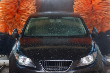 soap suds: Dotted with soap suds Tunnel Car Wash Automatic Car with rotating rollers Stock Photo