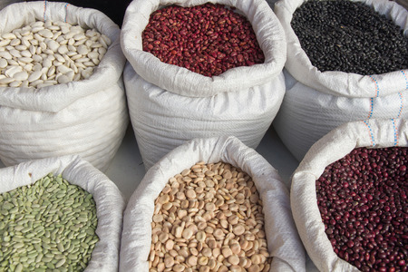 lima bean: Different types of beans  arranged in sacks for sale on the market Stock Photo
