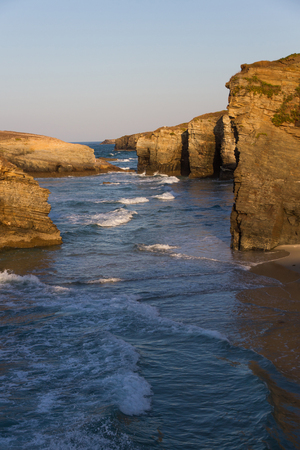 cantabrian: Ocean waves beating reaching the coastal cliffs at sunset. Cantabrian coast in Galicia Stock Photo