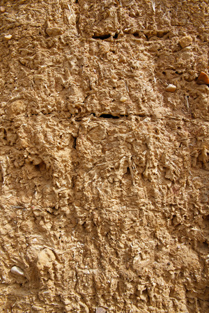 adobe wall: Texture or background wall ocher adobe mud mixed with straw baked in the sun