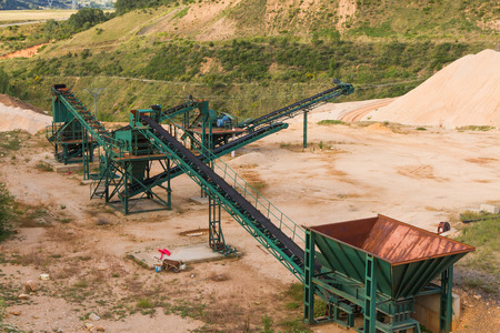 Recycling plant material Gravera with ribbons distribution and gravel piles of gravel or sand for the construction industry Standard-Bild