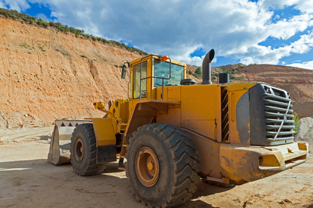 gravel pit: Vehicle rear side view machine shovel excavator and loader, clearing In a gravel pit