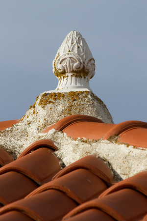 pinnacle: Decorating pinnacle or finial summit  of a traditional roof