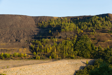 Landscape altered by coal mine waste dump of open pit retaining wall waste
