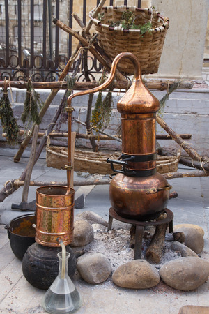 essences: Copper still to distill and create perfumes or essences, exposure outdoors in the laboratory or workshop simulating a perfumer