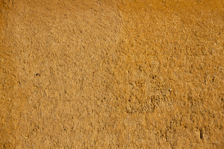 adobe: Texture or background adobe wall ocher mud mixed with straw baked in the sun Stock Photo