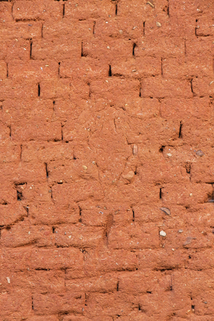 reddish: Wall built of mud bricks and straw adobe With reddish clay