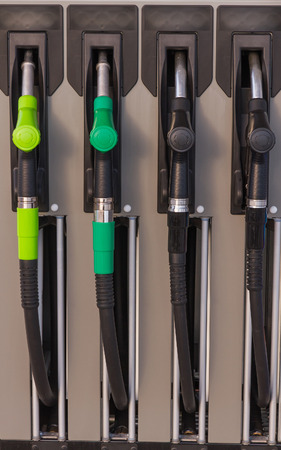 energy suppliers: Four jet nozzles or hoses With tap for dispensing fuel at a gas station