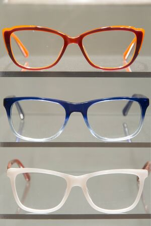rimmed: Placed on colored glasses frames to display for sale