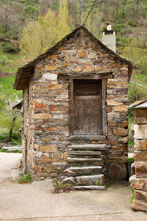 edification: Small old traditional stone built house. With the steps of the staircase leading to the main gate built with stone slabs Stock Photo