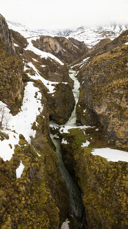 lockdown: Sil river view near the place of His birth, from the top of the Puente de las Palomas, sandwiched Between the rocks. Limestone mountainous landscape in winter with snow Stock Photo