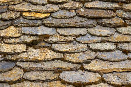 slate roof: Detail of rural old slate roof, with upholstered slabs of moss and lichen Stock Photo