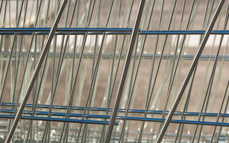 shopping carts: Metal mesh FORMED supermarket with shopping carts Stock Photo