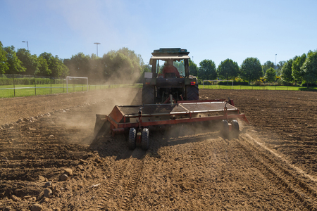 cleanser: Tractor cleanser stones lowering the rake to separate or remove the stones of the land. In This case the construction of a football