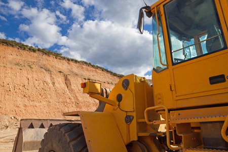 gravel pit: Vehicle side view machine shovel excavator and loader, clearing In a gravel pit