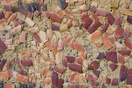 adobe wall: Adobe wall with roof tiles glued to Protect Against inclement weather Stock Photo
