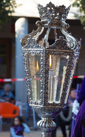 liturgical: Lighted lantern, supported by a brother in a procession of Holy Week