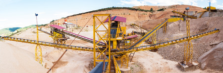 classifier: Panoramic view of gravel with ribbons ACCORDING TO sizes distribution in the gravel quarry outdoors