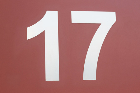 yearbook: Label number 17 in white wall in brown or reddish stuck