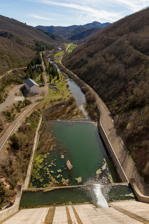 coronation: Aerial View, from the coronation, or dam concrete dam in swamp With a stream of mouth releasing water and the bed of the river flowing through a narrow valley between mountains and hills