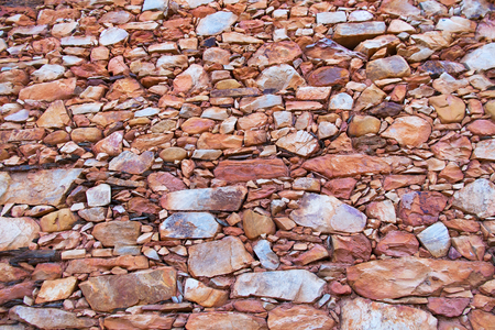 reddish: Stone wall texture edges and slabs in traditional construction, with reddish tones Stock Photo