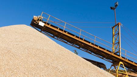 gravel pit: Conveyor gravel or sand and gravel pile