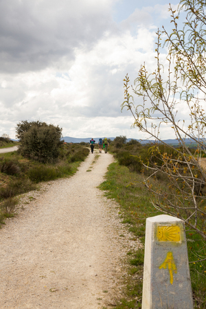 indicative: Pilgrims walking the Way of St. James passes through the province of Leon. With cairn signal indicative of the route in the first place