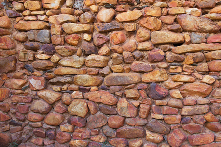 oxides: Stone wall with reddish edges and slabs oxides Stock Photo