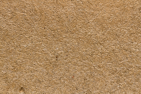 Texture or background ocher adobe wall (mud mixed with straw baked in the sun)