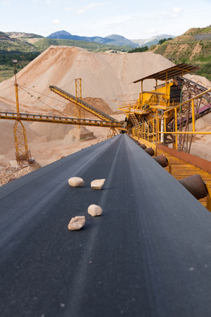 size distribution: Machinery and size distribution Classification according gravel via conveyor belts in mountainous landscape with piles of gravel and sand Stock Photo