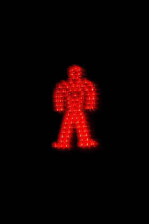 Symbol not go through pedestrian in red light on dark background - Simbolo de no pasar con peaton en semaforo en rojo sobre fondo oscuro  semaforo, rojo, peaton, no pasar, prohibido, humano, figura, simbolo, luz, piloto,  encendido, alto, pare,  indicad