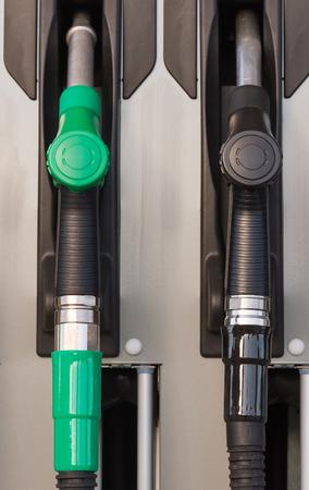 Two jet nozzles or hoses with tap for dispensing fuel at a gas station - Dos boquillas de surtidores o mangueras con grifo para expender combustible en una gasolinera  surtidores; gasolinera; gasolina; boquillas; mangueras; combustible; dos; grifos; ve Banco de Imagens