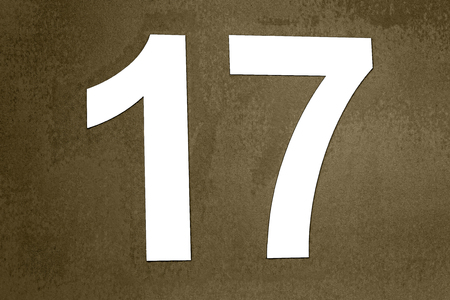 Label number 17 in white wall stuck on dirty or degraded digital background- Rótulo de numero 17 en color blanco pegado en fondo digital sucio o degradado   17, numero, numero 17, año, 2017, blanco, placa, pegado, relieve, numeracion, caracteres, 1, 7,
