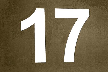 Label number 17 in white wall stuck on dirty or degraded digital background- R�tulo de numero 17 en color blanco pegado en fondo digital sucio o degradado   17, numero, numero 17, a�o, 2017, blanco, placa, pegado, relieve, numeracion, caracteres, 1, 7,