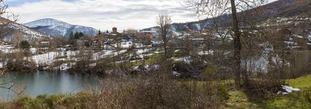 Panoramic overview of a town in the province of Palencia in Spain, next to a swamp in winter and snow